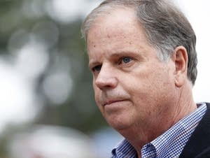 Doug Jones campaigning on Dec. 4.