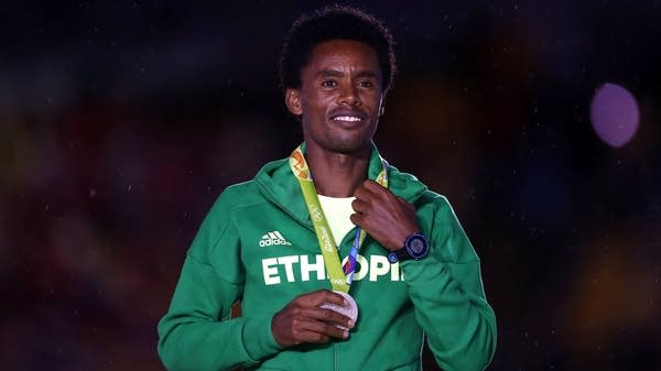 Silver medalist Feyisa Lilesa of Ethiopia