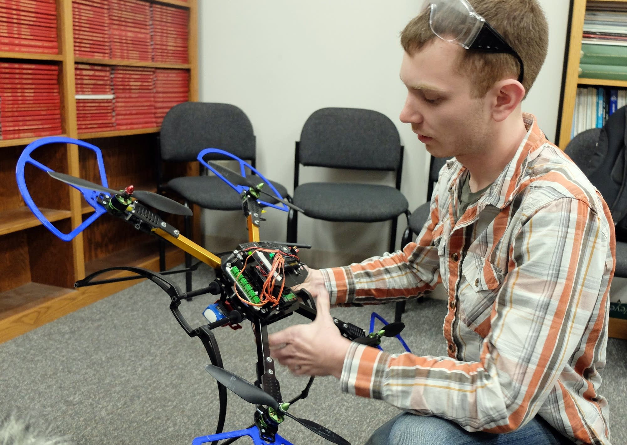 NDSU engineering student Brady Goenner explains the design of a drone.