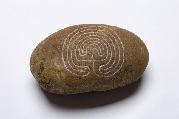 large potato with a labyrinth carved into it