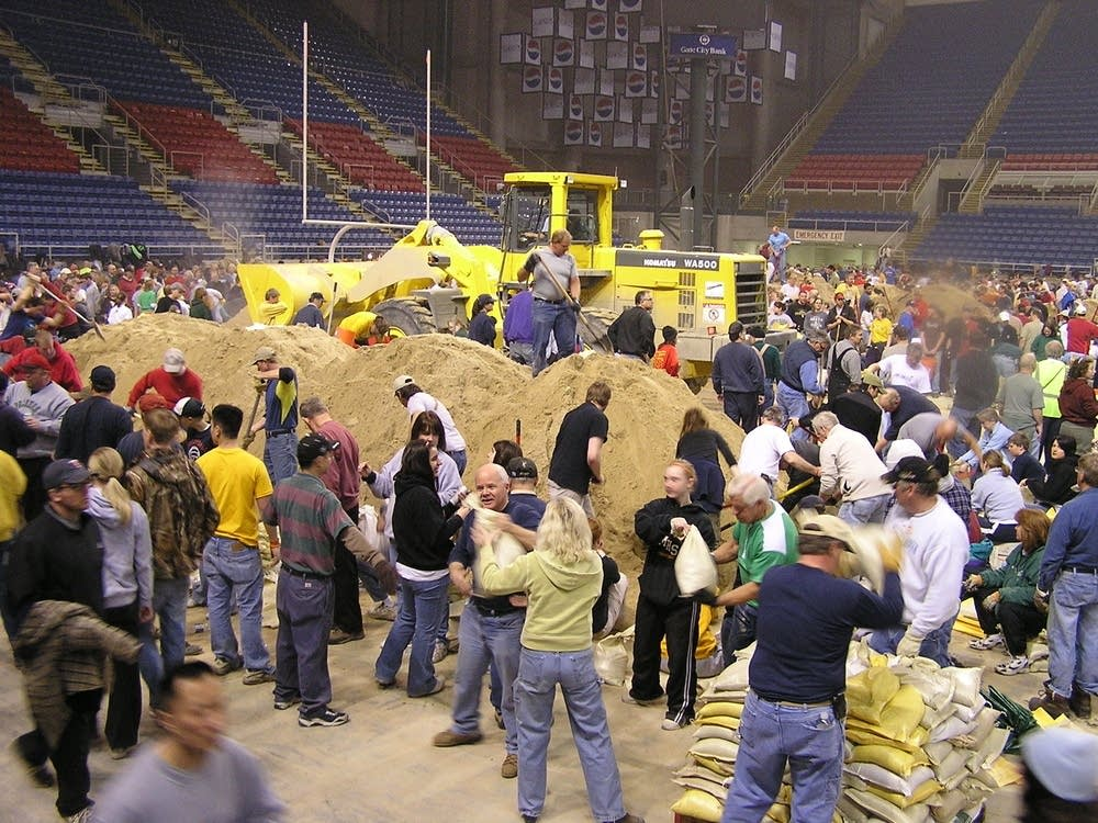 Volunteers  fill sandbags at the Fargodome Sunday
