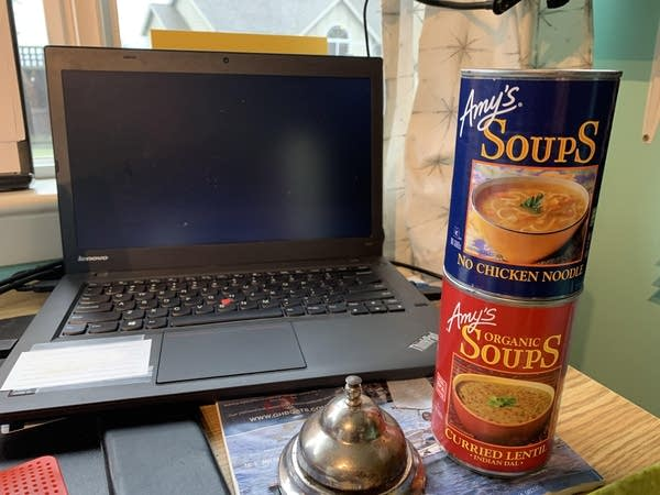 Two cans of Amy's soup sitting on Luke's desk