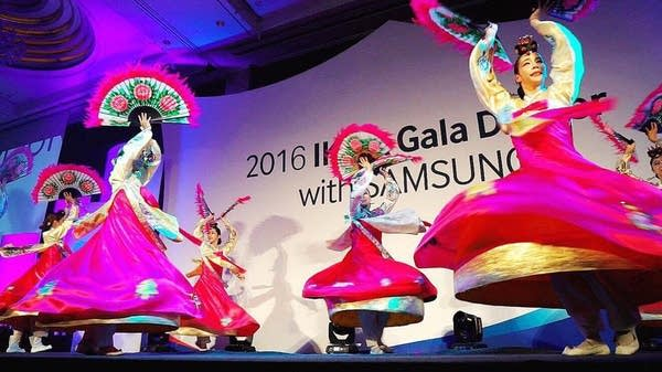 A traditional Korean fan dance at a gala dinner.