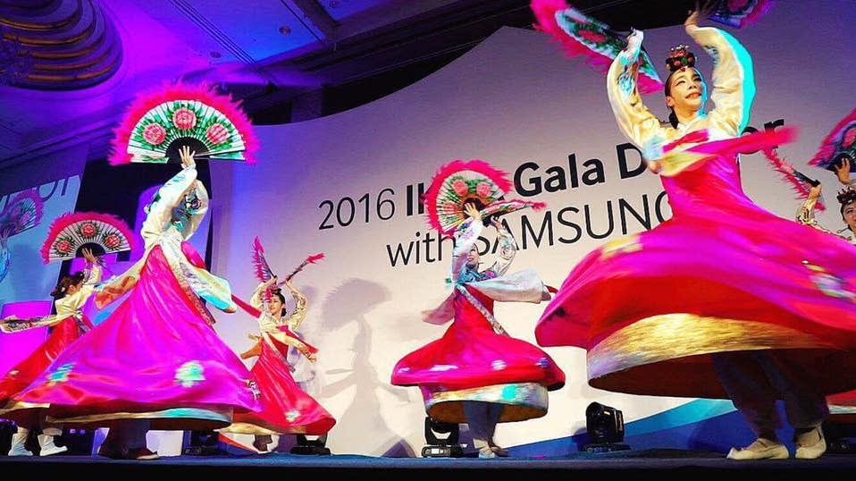 A traditional Korean fan dance at a gala dinner.