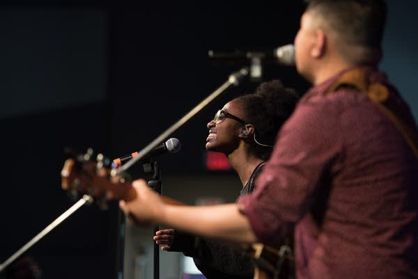 Aantuu Mengitsu, left, sings with the worship band from Crown College.