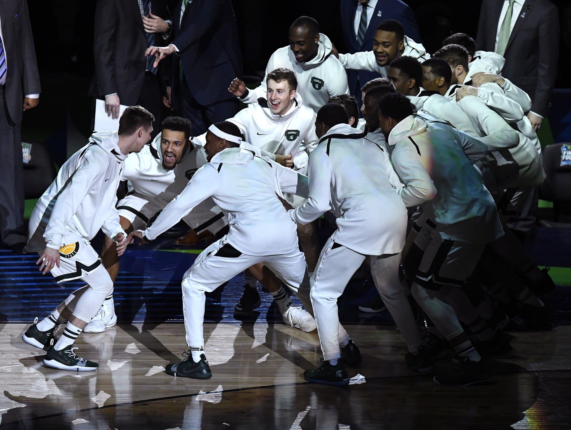 Michigan State players huddle