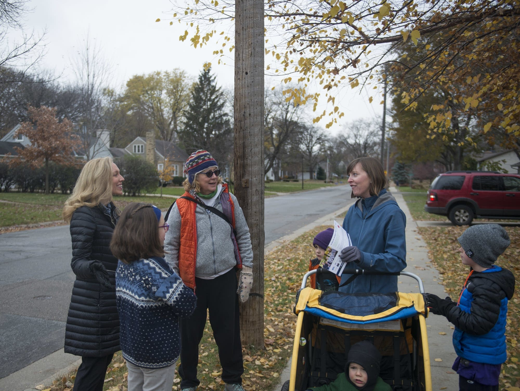 Heather Edelson speaks to passers-by while canvassing in Edina.
