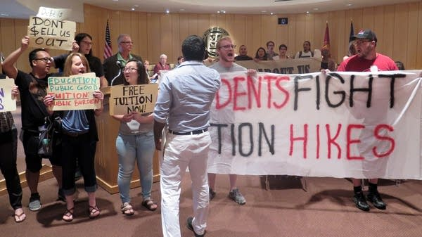 Protesters interrupt the Board of Regents meeting.