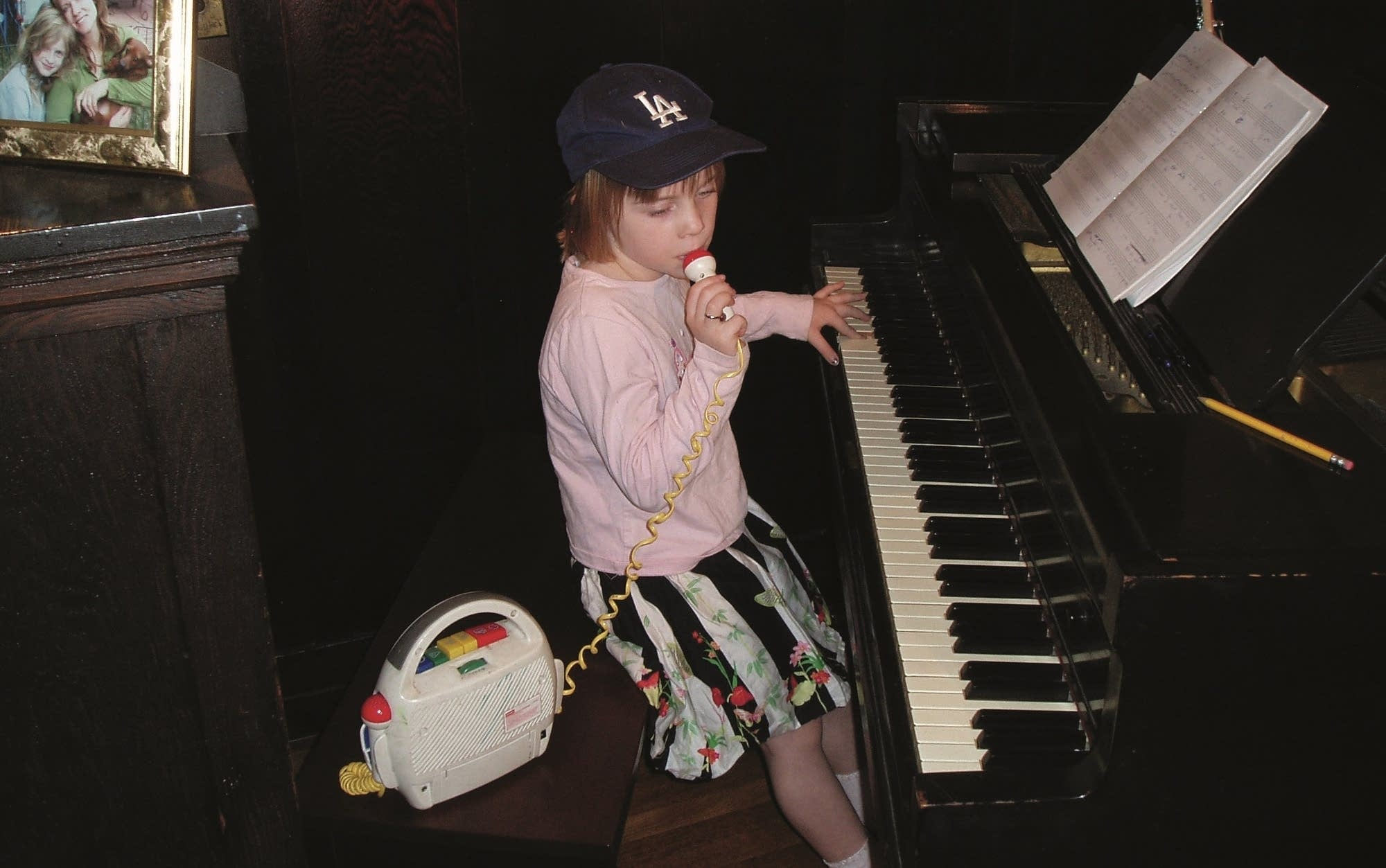 Young child sings into microphone.