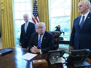 President Donald Trump, with V.P. Mike Pence and HHS Secretary Tom Price