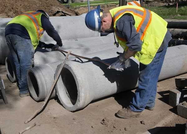 St. Paul workers prepare new copper pipe.