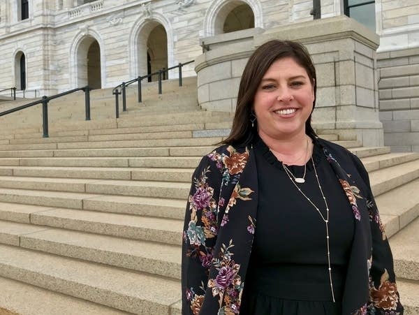 Jenny Teeson stands in front of the State Capitol.