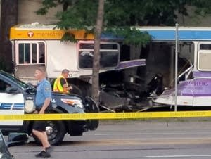 A car ran through at Metro Transit bus, killing at least one.
