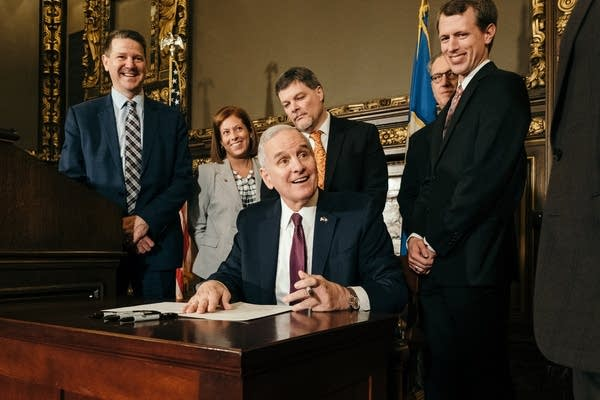 Mark Dayton signs a bill allowing the construction of a new power plant.