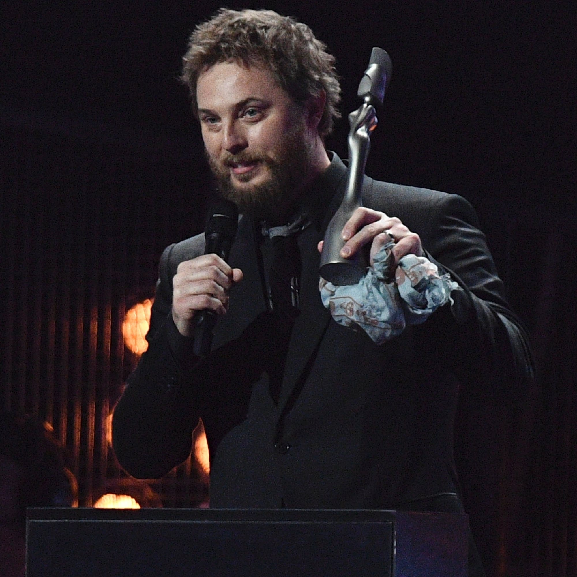 Duncan Jones accepts a BRIT Award on behalf of his father, David Bowie