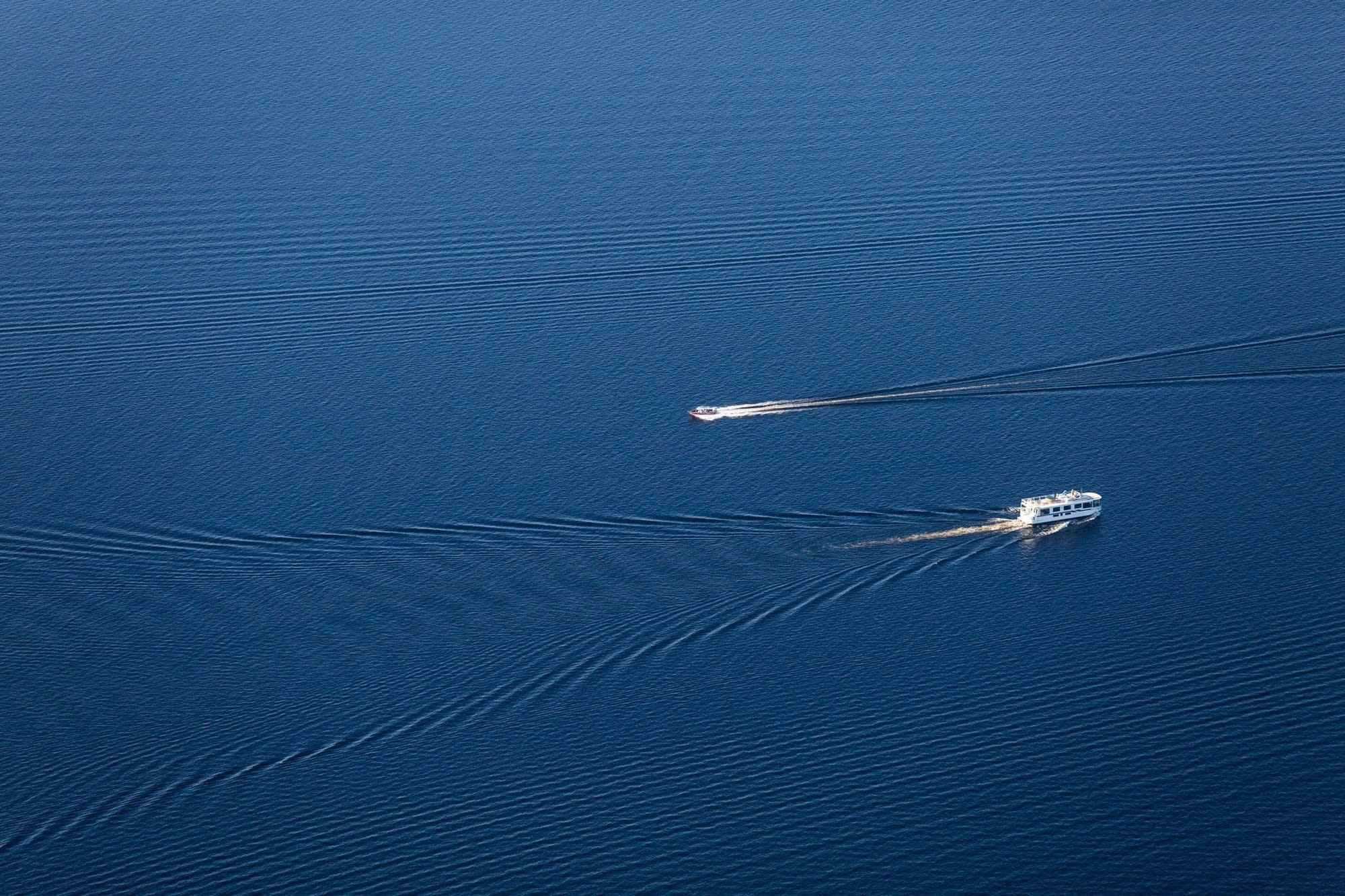 Boats drive on Namakan Lake.