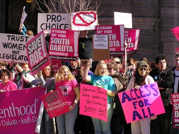 women protest South Dakota's abortion ban