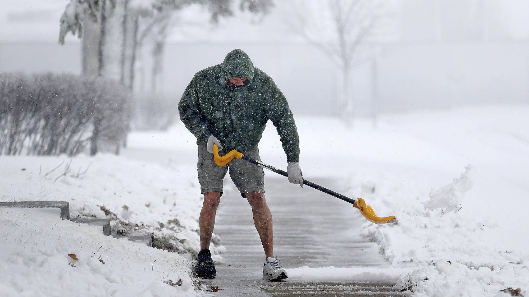 Peter Lidstone shovels his sidewalk during a storm
