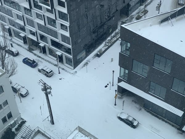 Aerial shot of a Portland, OR, city intersection w/ fresh snow