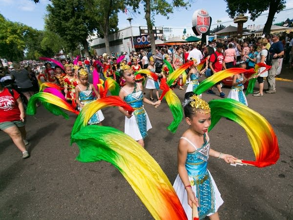 Dancers walk in the State Fair parade in 2015.