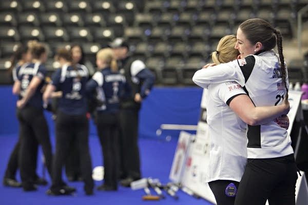 Jamie Sinclair and Alex Carlson embrace after winning the national title.