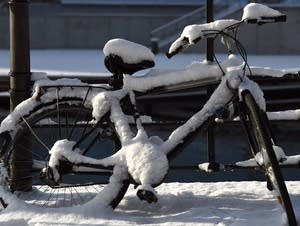 A snow covered bicycle