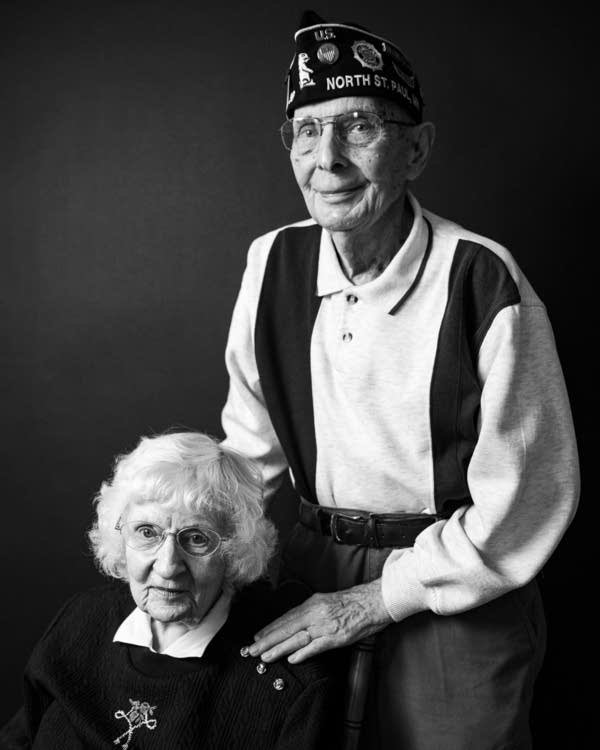 Two people in a black and white portrait.
