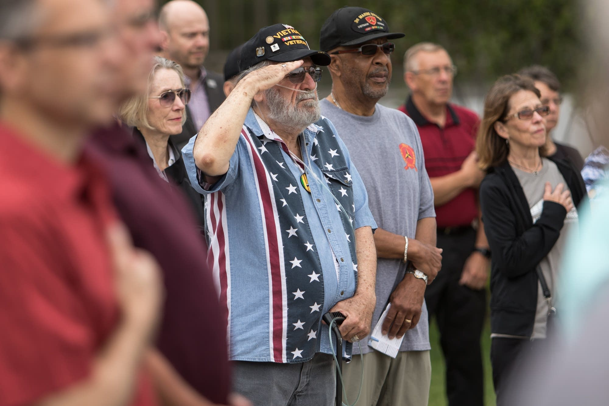Jim Lee, who served in the Navy during the Vietnam War, salutes the flag.
