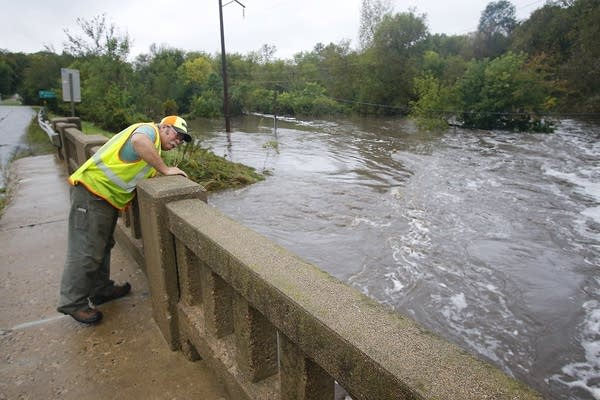 Greg Peters, with MN-DOT, checks bridge supports.