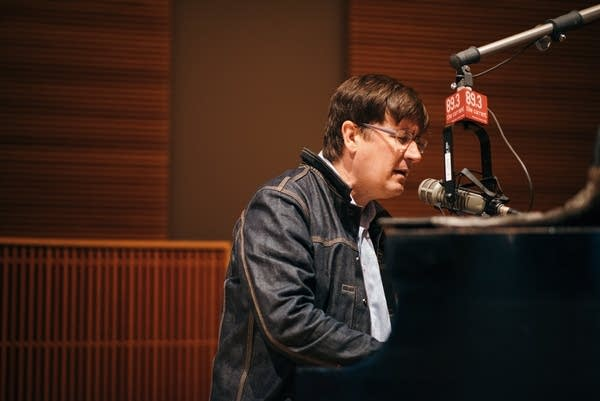 John Darnielle of Mountain Goats playing piano in The Current studio