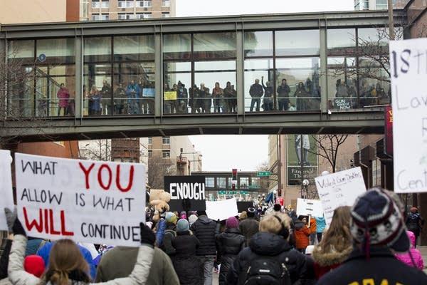 Marchers head down Wabasha Street toward the State Capitol.