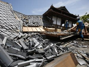 Checking damaged homes in southern Japan