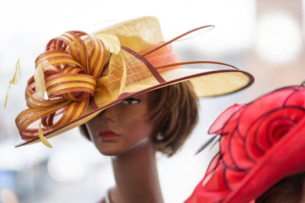 A church hat sits on a mannequin's head.