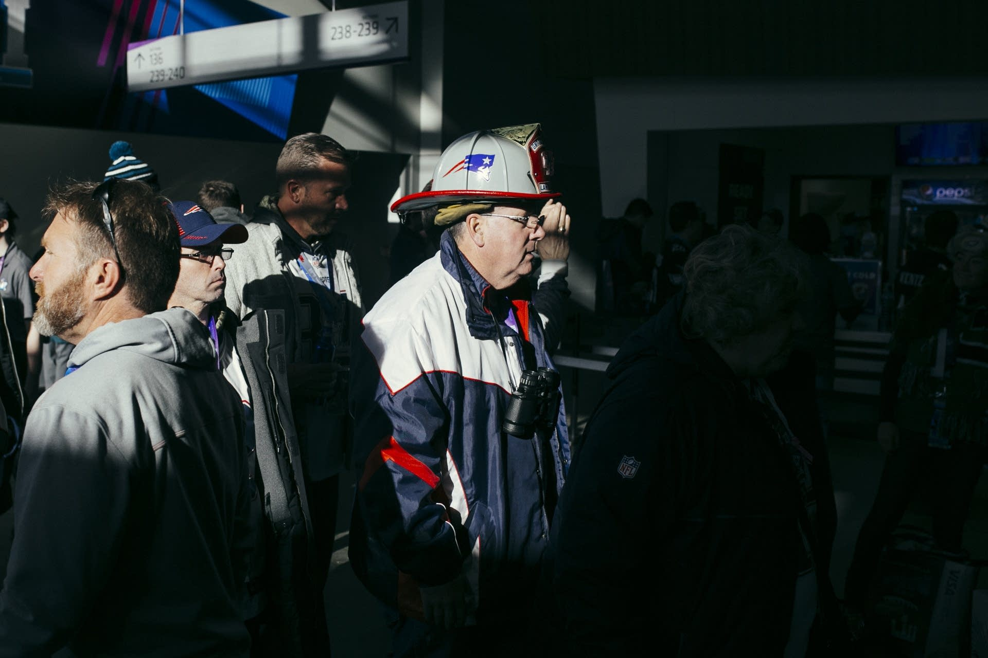 Firefighter Pat Driscoll of Lawrence, Mass. walks through the concourse.