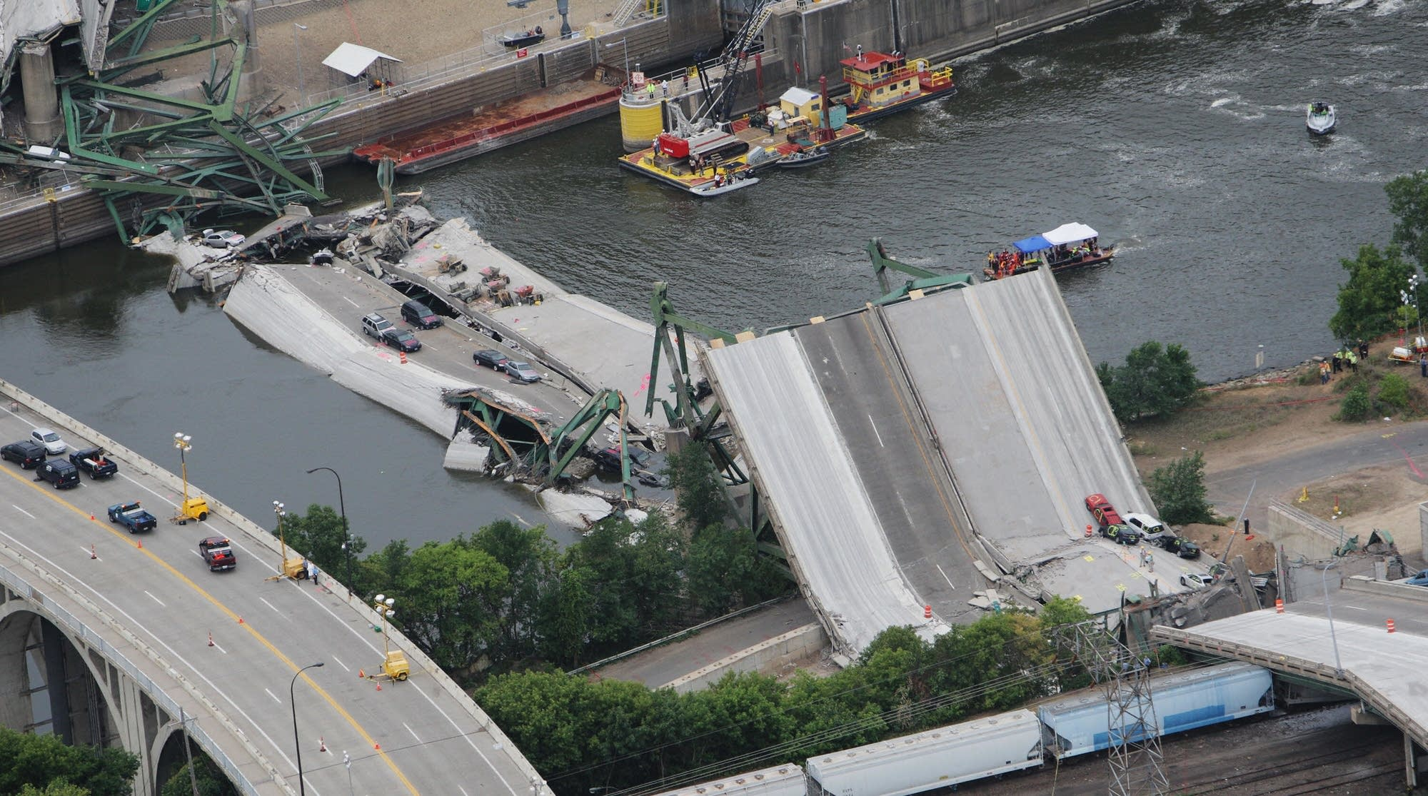 An aerial view shows the collapsed I-35W