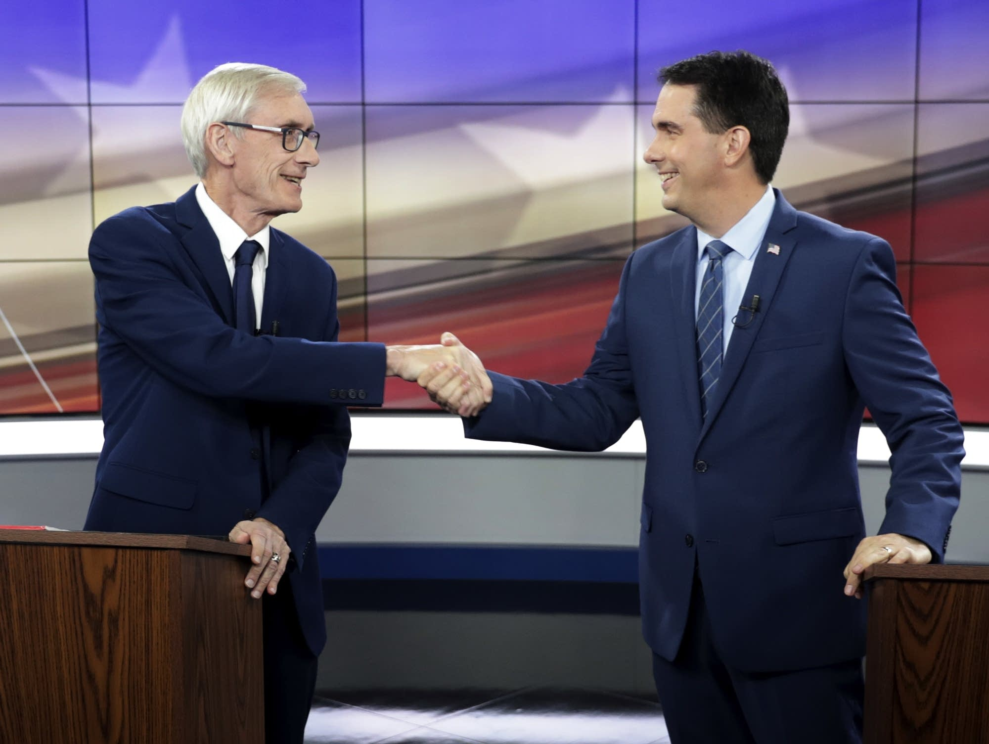 Democrat Tony Evers, left, and Wisconsin Gov. Scott Walker, a Republican
