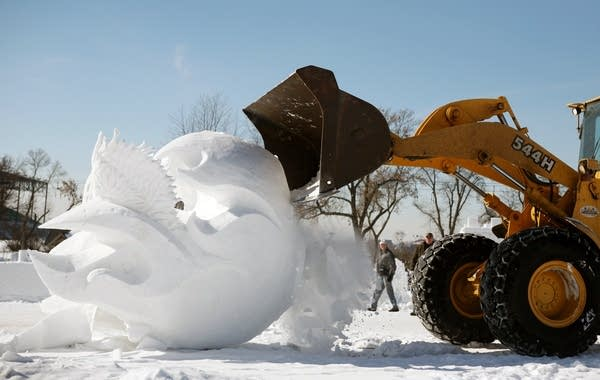 Snow sculptures topple