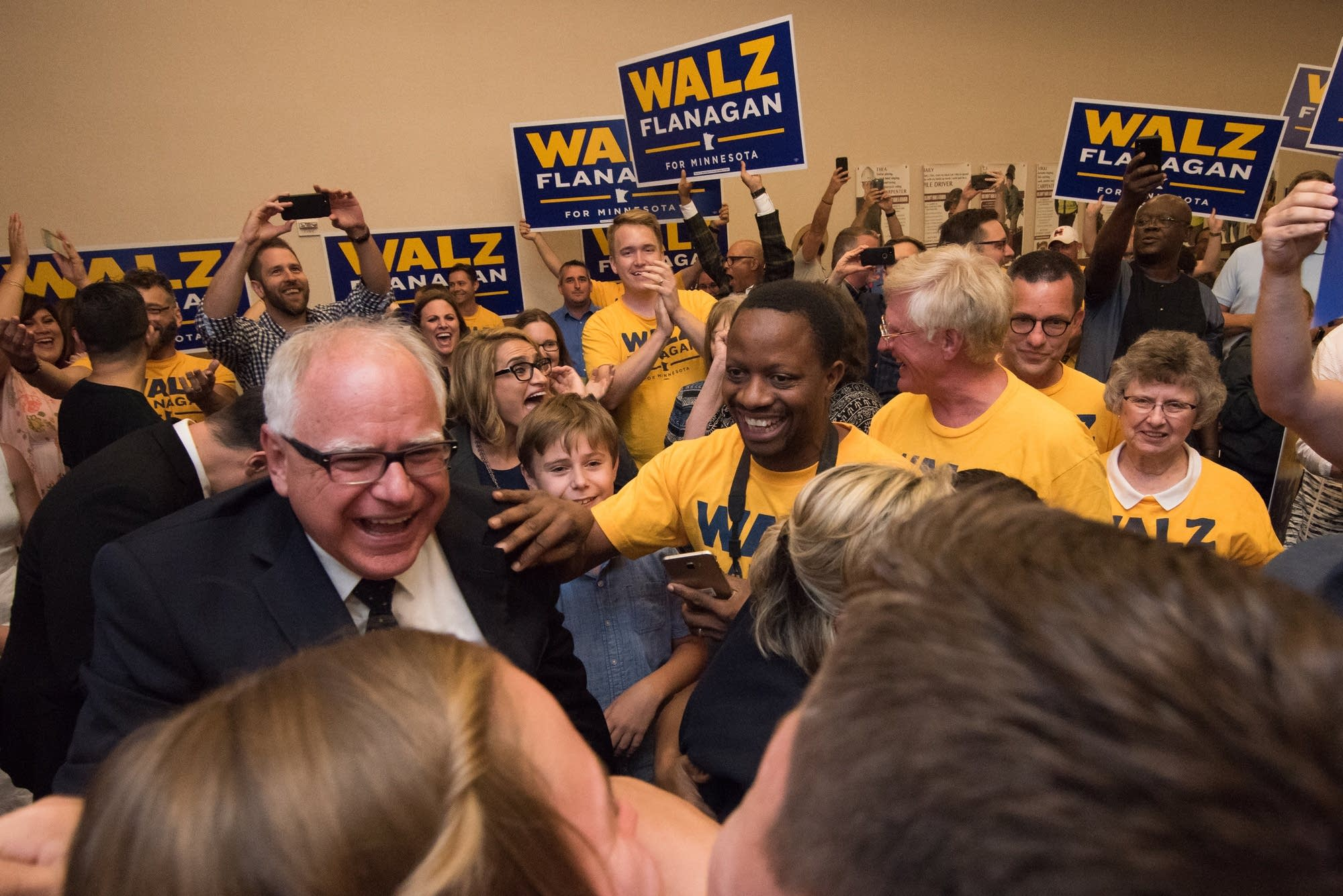 Walz greets supporters before a victory speech during a primary party.