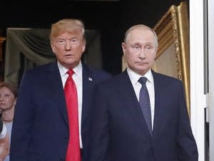 Putin and Trump arrive for a meeting in Finland