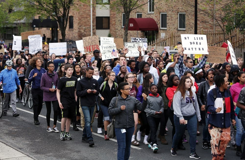 Students march along Nicollet Avenue