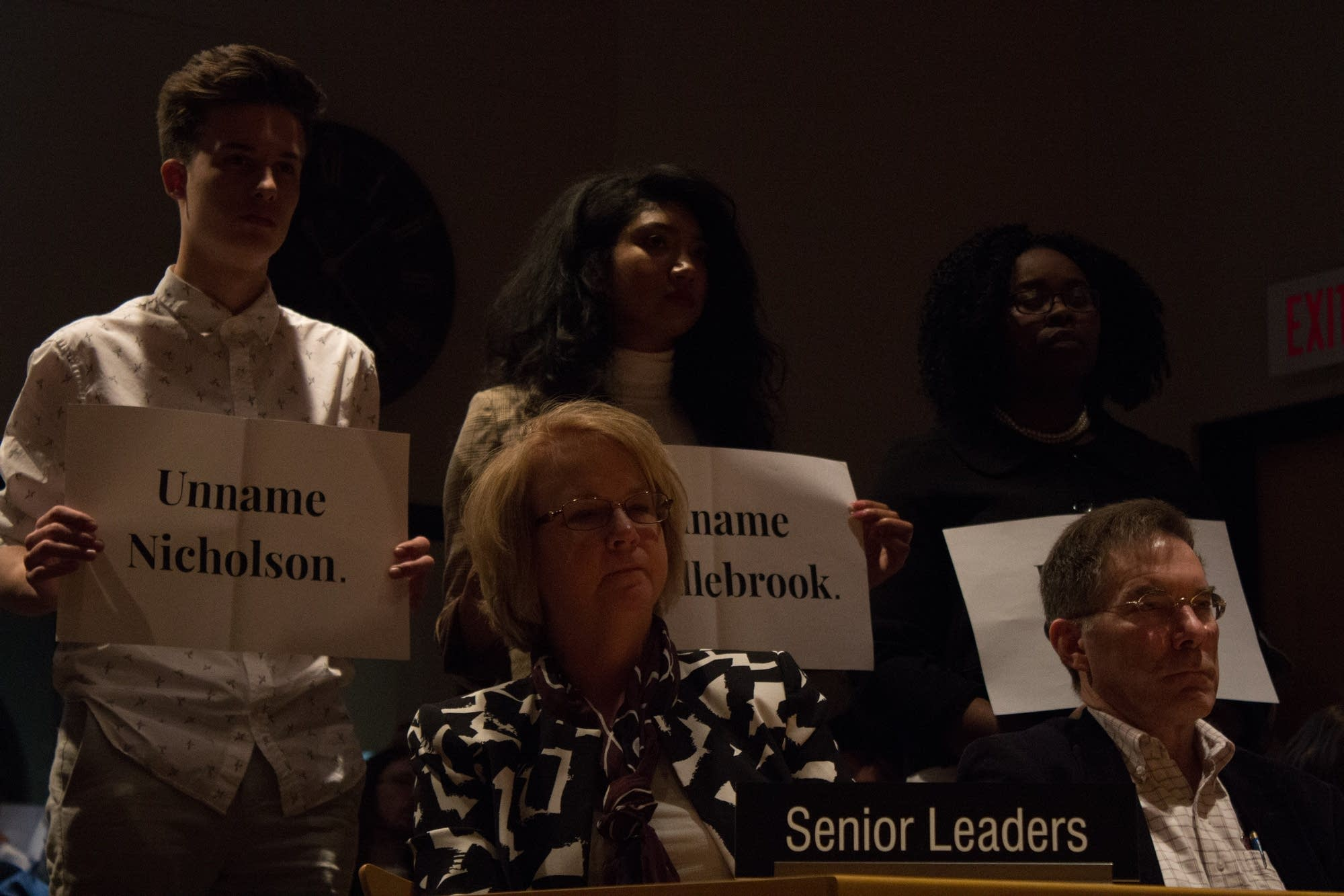 Students protest building names at a regents meeting