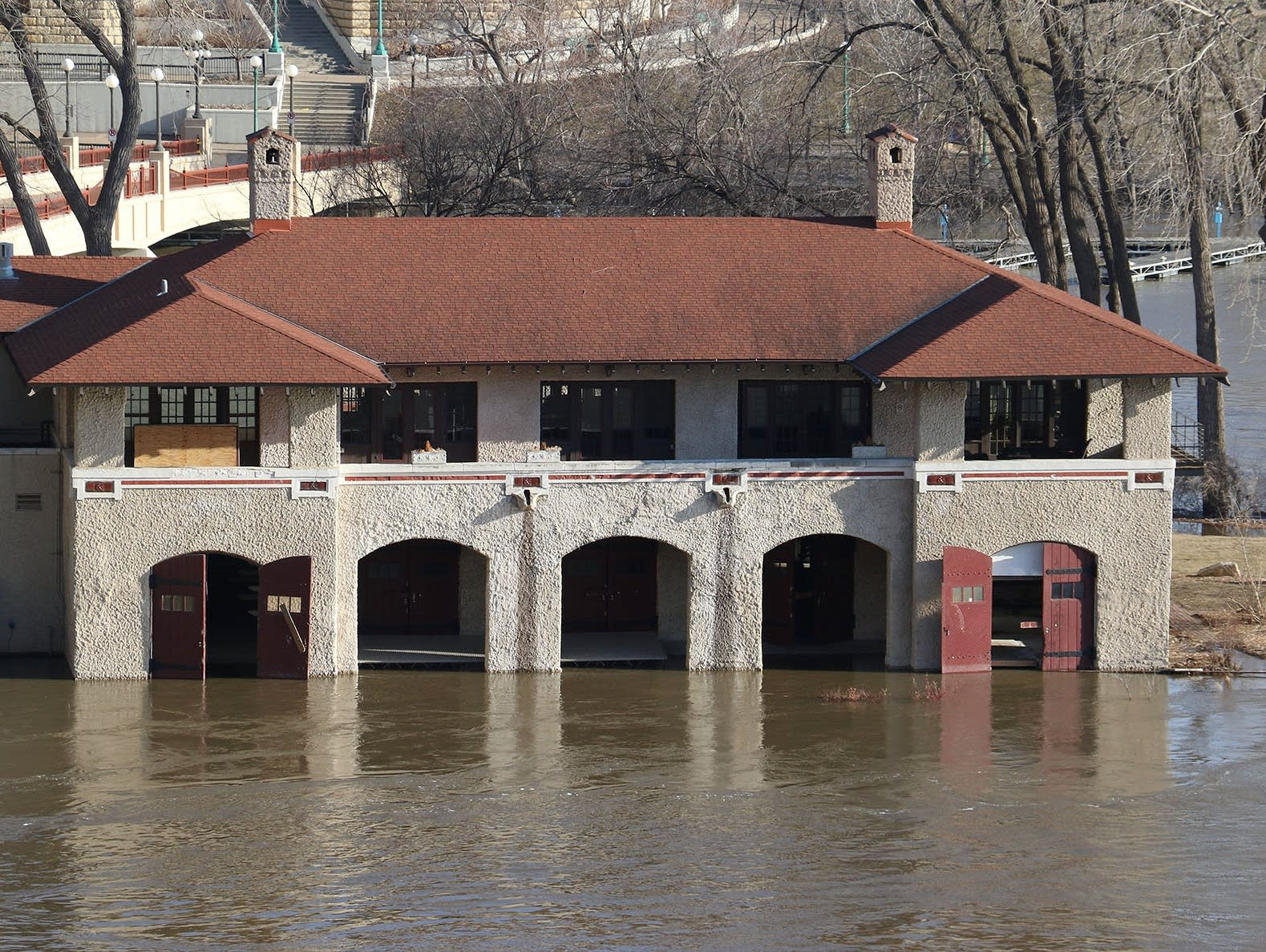 Mississippi River floodwaters lap at the Minnesota Boat Club