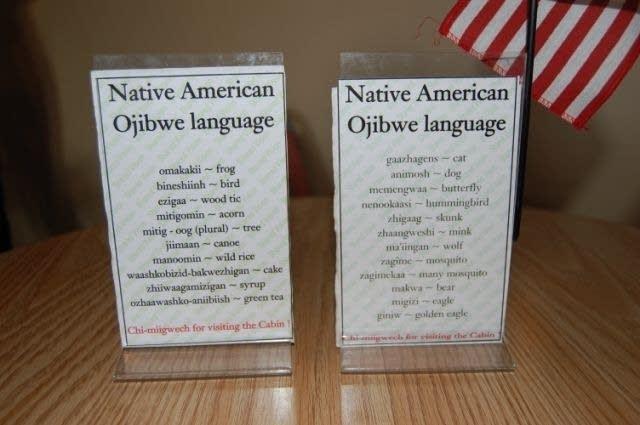 Ojibwe-English table signs