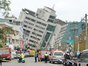 A building leans the morning after a 6.4-magnitude quake in Taiwan.