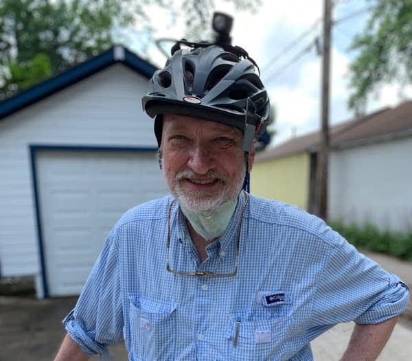 A person wearing a bike helmet.