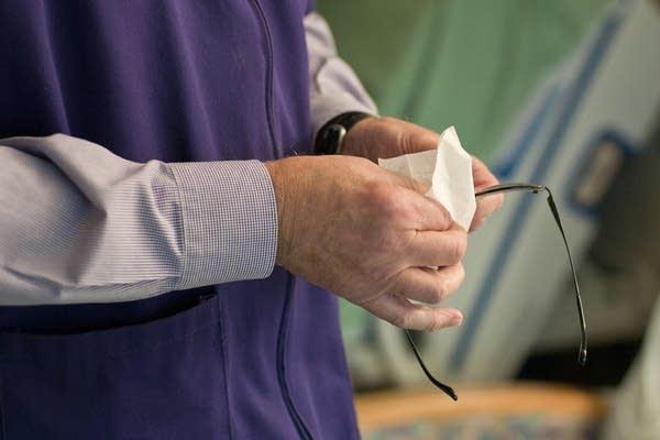 Ev Weinstein cleans Ellen Reierson's glasses.