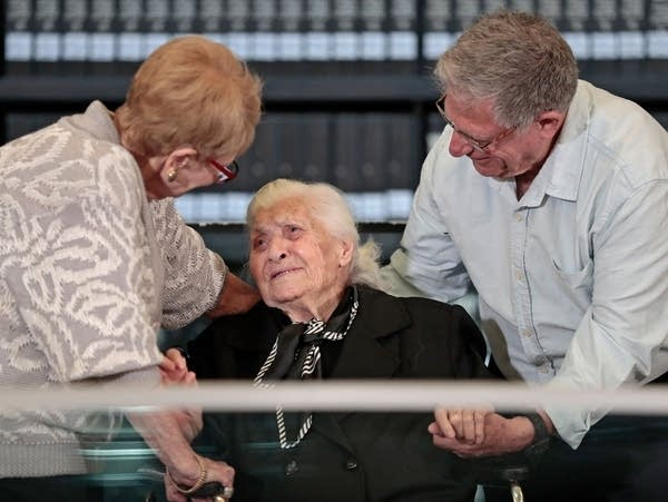 Melpomeni Dina reacts as she is reunited with Holocaust survivors