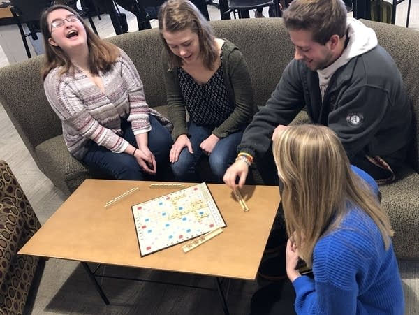 UMD students at a lounge playing scrabble.