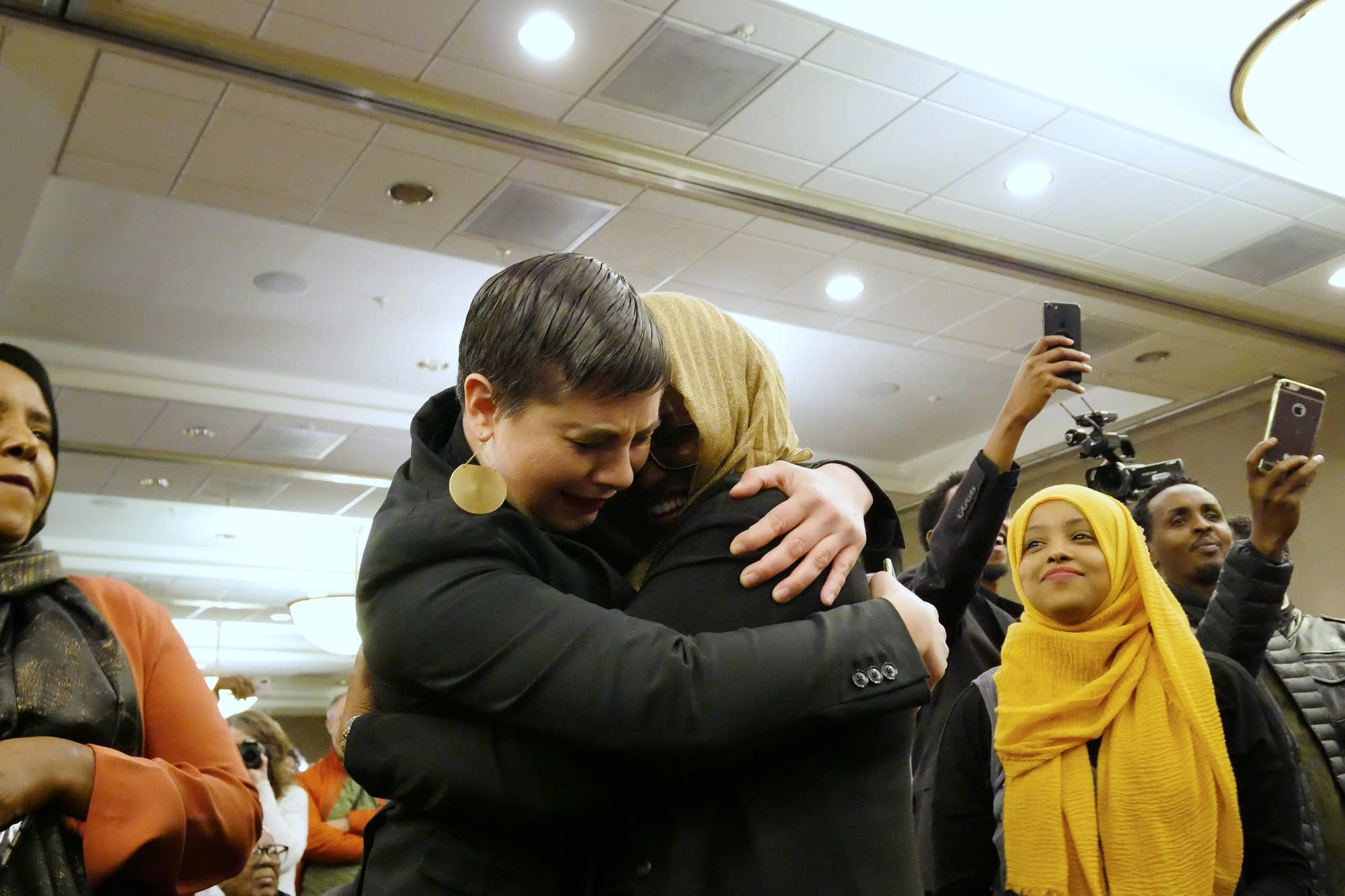 Omar supporters hug during her victory party.
