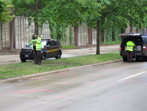 Hennepin County sheriff's investigators work along 77th Street East